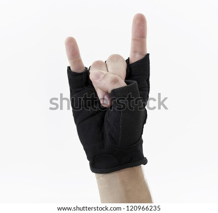 Rock sign, gloved hand - stock photo