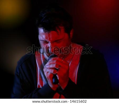 Rock singer on a scene singing rock in ecstasy - stock photo