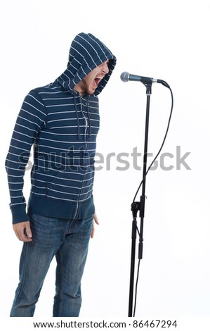 rock singer with his mouth open screaming in microphone isolated on white - stock photo