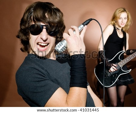 Rock singer with woman during in studio. - stock photo