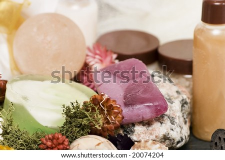 rock, spa soaps, flowers and rocks - stock photo
