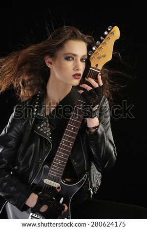 Rock star and her electric guitar - stock photo