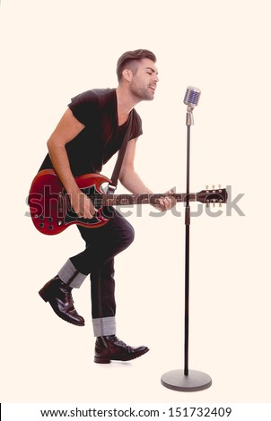 rock star singing with guitara and micorphone - stock photo