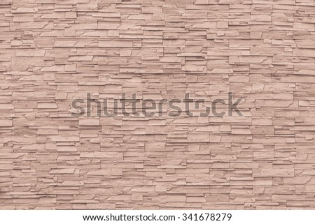 Rock stone brick tile wall aged texture detailed pattern background in dark red brown color tone: Grunge ancient rustic limestone patterned backdrop for decoration in red  brown toned colour - stock photo