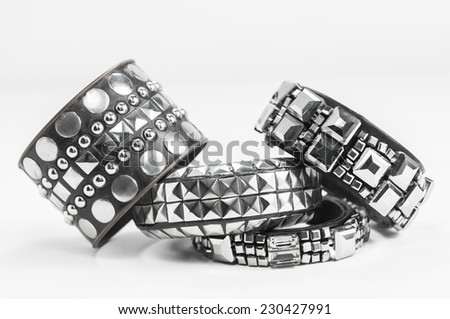 Rock style braided leather and metal bracelet isolated on white background - stock photo