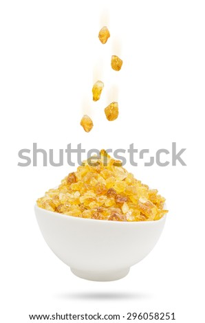Rock Sugar falling in a cup of white isolated on white background with clipping path. - stock photo