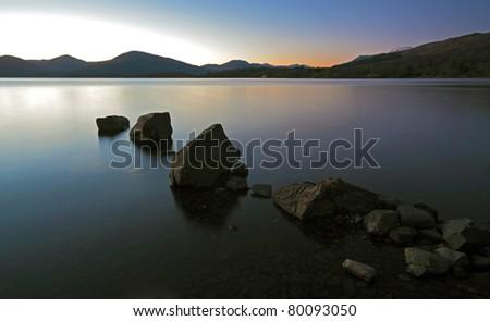 Rock Sunset on Loch Lomond - stock photo
