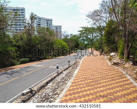 Rock walkway and road on mountain - stock photo