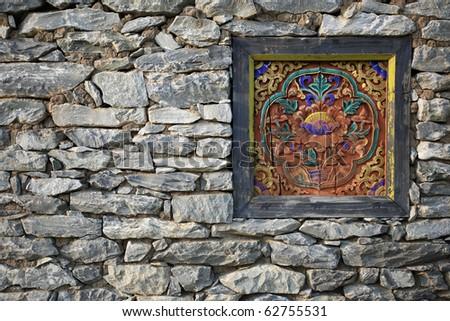 rock wall chinese window - stock photo