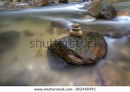 Rock with zen formation shot in small stream