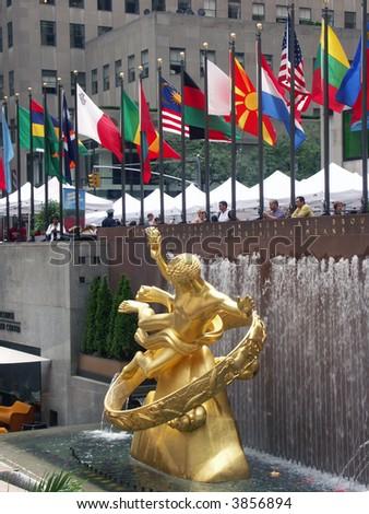 Rockefeller center in NYC - Golden statue of  Prometheus - stock photo