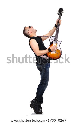 rocker is playing electrical guitar - stock photo