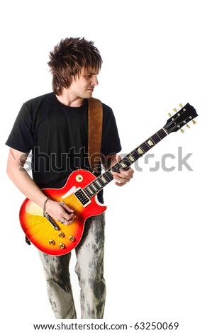 Rocker with his classic acoustic guitar - stock photo