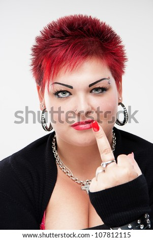 Rocker woman showing middle finger, scrooge you, fuck you - stock photo