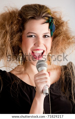 Rocker woman with messy hairdo singing with a microphone