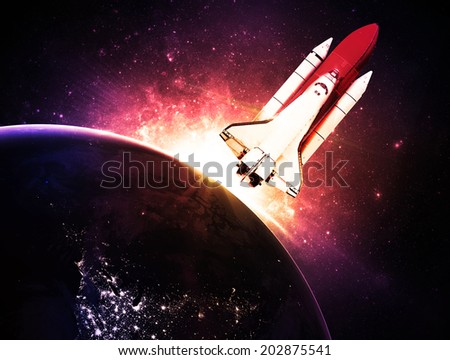 Rocket Against Magenta Sunset - Elements of this Image Furnished By NASA - stock photo