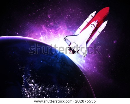 Rocket Against Violet Sunset - Elements of this Image Furnished By NASA - stock photo