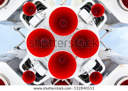 rocket engine and red nozzle engines on blue sky background - stock photo