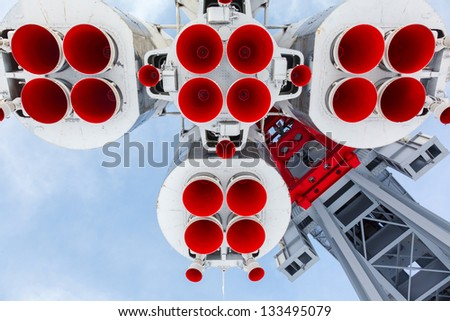 rocket engine and red nozzle engines on the background of blue sky - stock photo