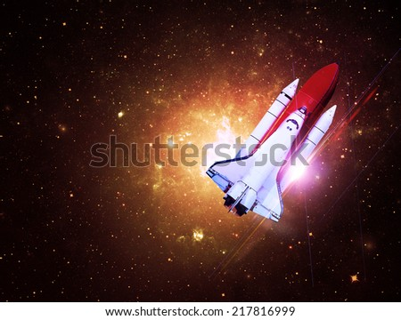 Rocket Flying Through Golden Starfield- Elements of this Image Furnished By NASA - stock photo