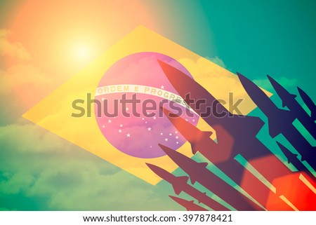 Rockets silhouettes background Brazil flag. Toned - stock photo