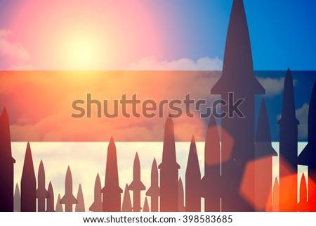 Rockets silhouettes background Estonia flag. Toned - stock photo