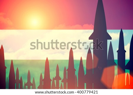 Rockets silhouettes background  Hungary flag. Toned - stock photo