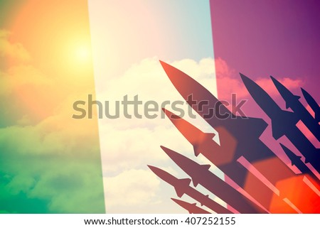 Rockets silhouettes background  Italy flag. Toned - stock photo