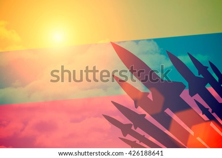 Rockets silhouettes background Lithuania flag. Toned - stock photo