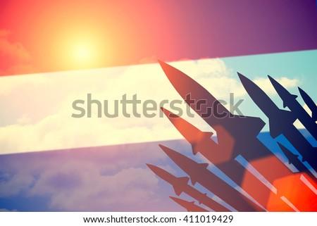 Rockets silhouettes background  Netherlands  flag. Toned - stock photo