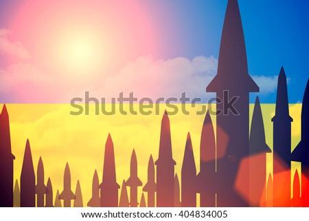 Rockets silhouettes background Ukraine flag. Toned - stock photo