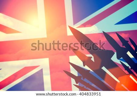 Rockets silhouettes background United Kingdom flag. Toned - stock photo