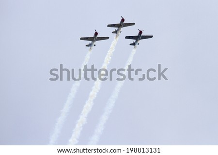 ROCKFORD, IL - JUNE 7: Airplanes from Team Aerostars demonstrates flying skills and aerobatics at the annual Rockford Airfest on June 7, 2014 in Rockford, IL - stock photo