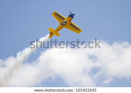ROCKFORD, IL - JUNE 3: Propeller airplane demonstrates flying skills and aerobatics at the annual Rockford Airfest on June 3, 2012 in Rockford, IL