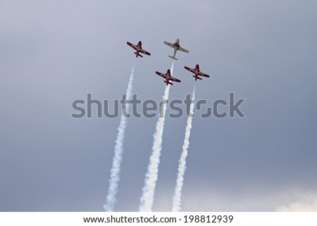ROCKFORD, IL - JUNE 7: Royal Canadian Air Force Snowbirds jet airplanes demonstrate flying skills and aerobatics at the annual Rockford Airfest on June 7, 2014 in Rockford, IL - stock photo