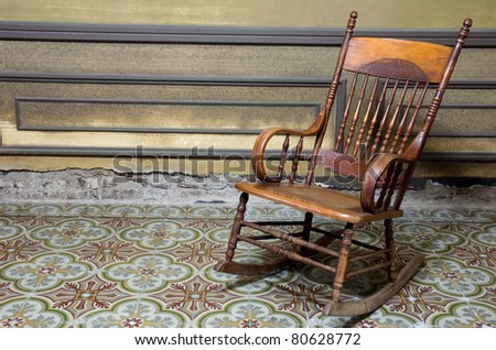 rocking chair in grunge house - stock photo