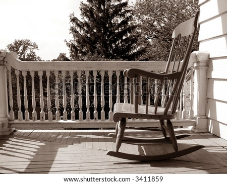 Rocking Chair On An Old House Porch In Nostalgic Sepia