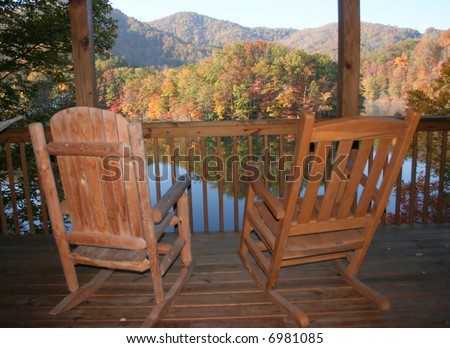 Rocking Chairs On A Porch Overlooking Lake In North Carolina Mountains.