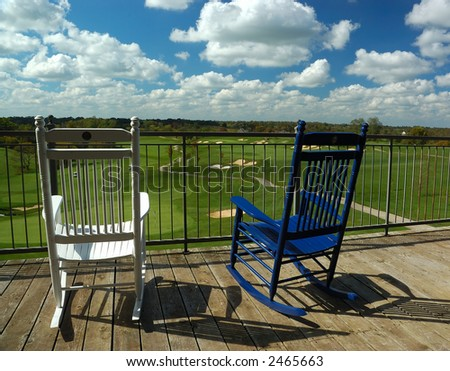 Rocking Chairs on Porch Overlooking Golf Course - stock photo