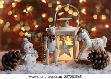 rocking horse,teddy bear and lantern on christmas background - stock photo