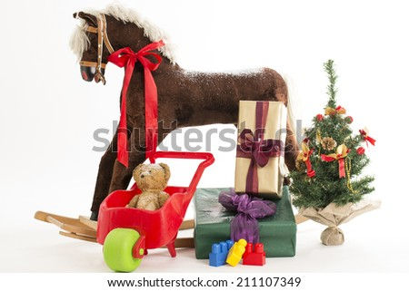 rocking horse with christmas gift - stock photo