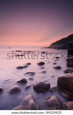 Rocks--a hazy morning by the beach - stock photo