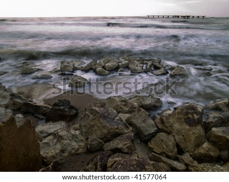 Rocks along a seawall - stock photo