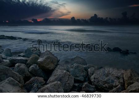 Rocks along the Galveston Seawall at Dawn - stock photo