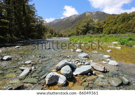 Rocks along the stream along the mountains - stock photo