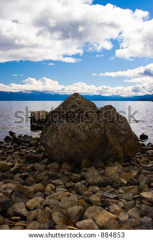 rocks and a boulder on a lake shore
