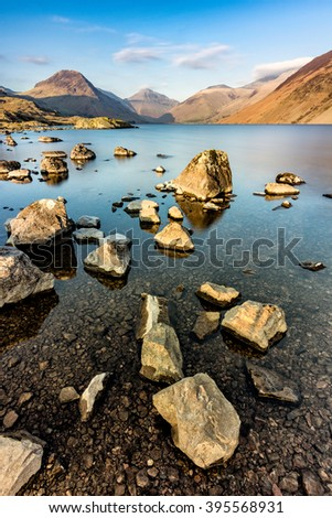 Rocks and boulders in lake shoreline at Wast Water in the English Lake District. - stock photo
