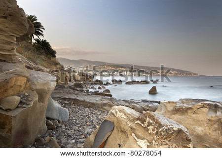 Rocks and cliffs in the Mediterranean Sea in Liguria Bussana at sunset