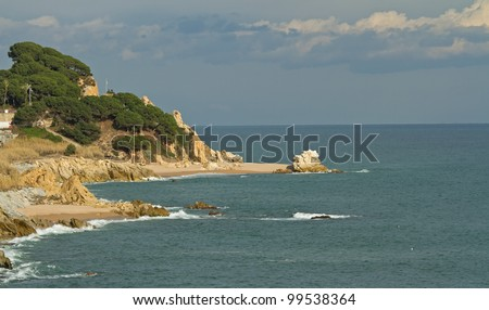 Rocks and sandy beach in Spain