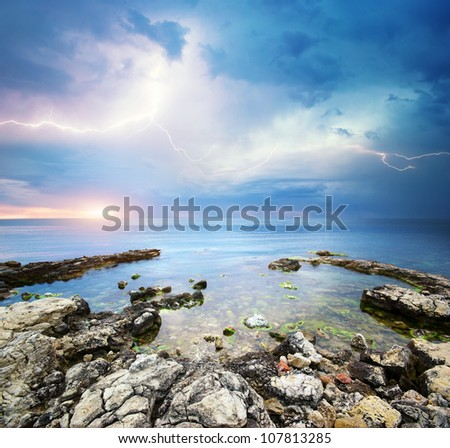 Rocks and sea storm. Dramatic scene. Composition of nature - stock photo